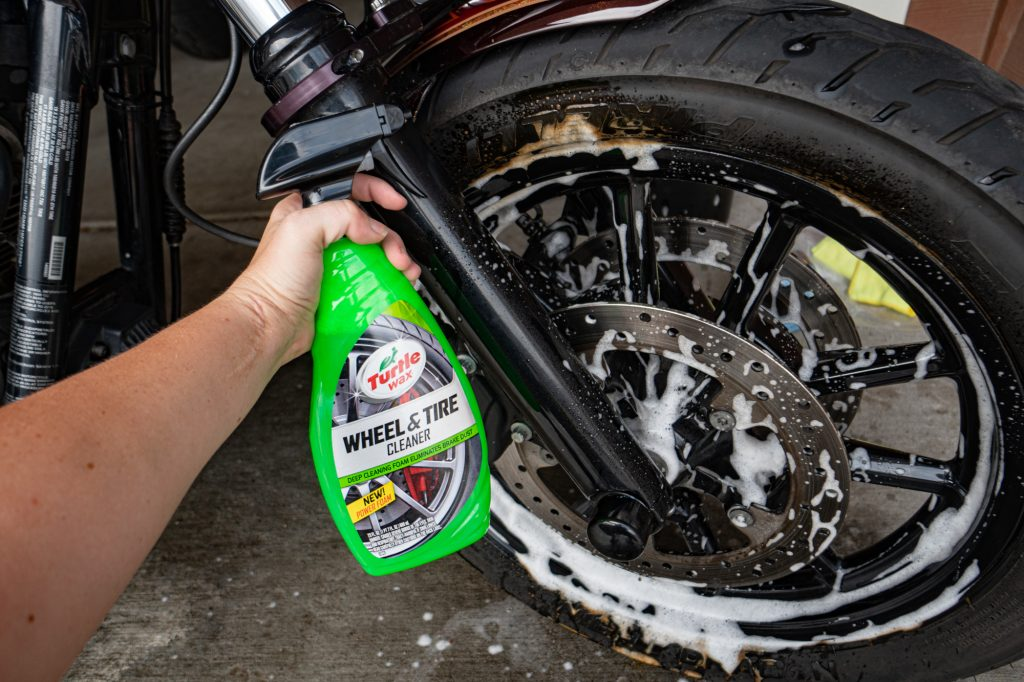 Turtle Wax Wheel and Tire Cleaner eats away at the residue on a motorcycle tire