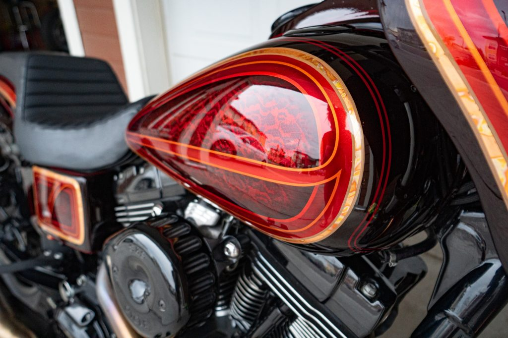 Maguiars Carnauba Wax applied to a motorcycle after wiping off excess wax from paint