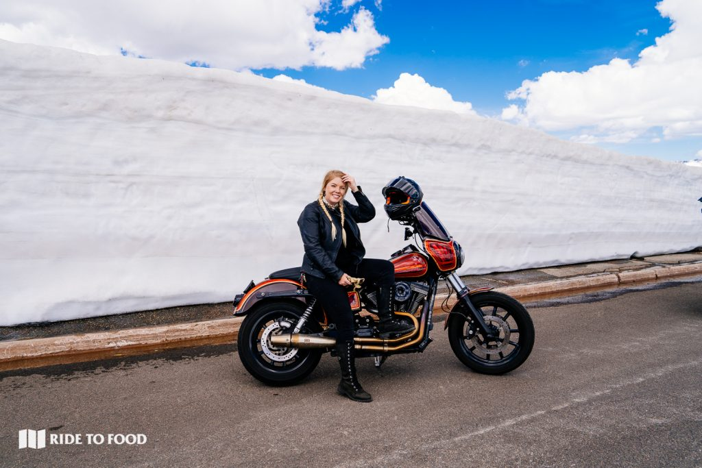 Motorcyclist with Snow Bank on Trail Ridge Road
